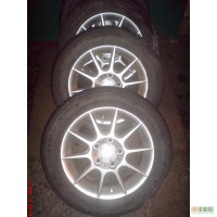 Продам диски Mazda626 комплект с резиной