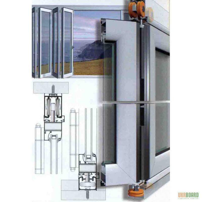 Алюминиевые рельса для раздвижных балконных окон.