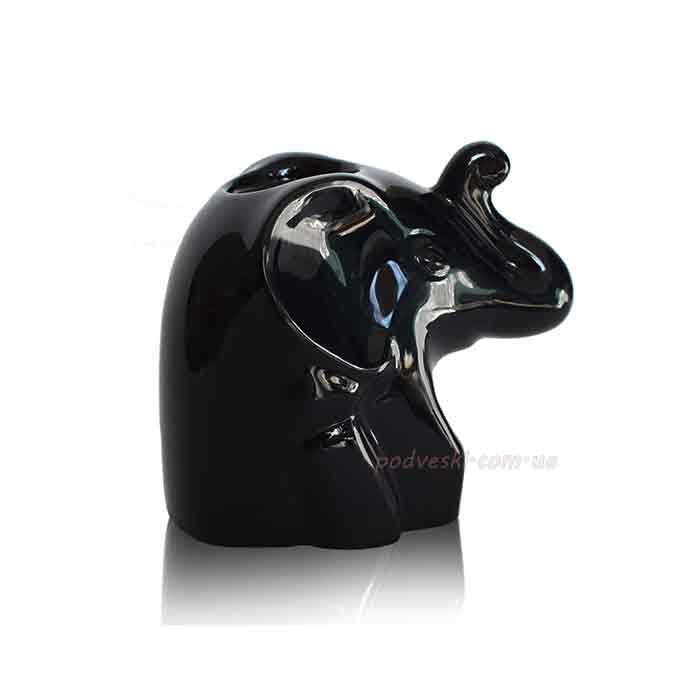 Фото 3. Керамические статуэтки: собака, коты, черепахи, носорог