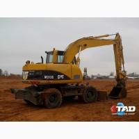Колёсный экскаватор Caterpillar M313C (2003 г)