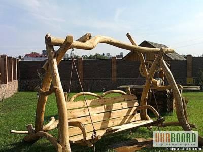 качелі дерев'яні фото