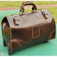 Продается большая дорожная кожаная сумка с выдвижной металлической тележкой, ...