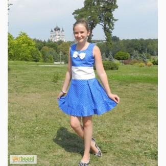 Нарядное платье в горошек с бантом для девочки