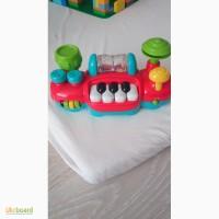 Музыкальный руль на коляску (крепится очень легко к бамперу) / пианино Mothercare