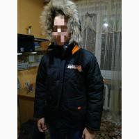 Продам б/у практичную и удобную зимнюю куртку DONILO с капюшоном