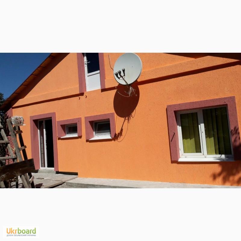 Отделка фасадов необрезной доской фото